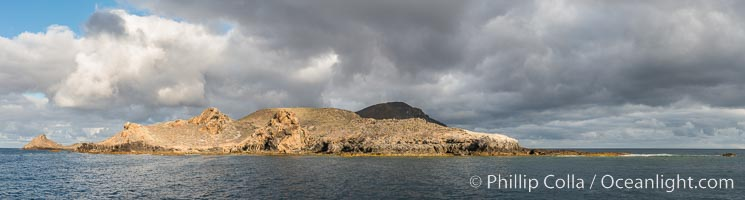 Sunrise at San Clemente Island, south end showing China Hat (Balanced Rock) and Pyramid Head, near Pyramic Cove, storm clouds. Panoramic photo