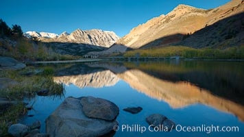 Sunrise on Paiute Peak, reflected in North Lake in the eastern Sierra Nevada, in autumn, Bishop Creek Canyon Sierra Nevada Mountains