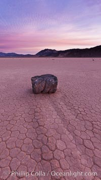 Sunrise on the Racetrack Playa. The sliding rocks, or sailing stones, move across the mud flats of the Racetrack Playa, leaving trails behind in the mud. The explanation for their movement is not known with certainty, but many believe wind pushes the rocks over wet and perhaps icy mud in winter, Death Valley National Park, California