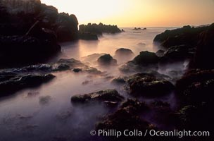 Sunset, tidepools and blurry water and mist, Pacific Grove, California