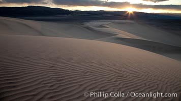 Sunset on the Eureka Dunes.  The Eureka Valley Sand Dunes are California&#39;s tallest sand dunes, and one of the tallest in the United States.  Rising 680&#39; above the floor of the Eureka Valley, the Eureka sand dunes are home to several endangered species, as well as &#34;singing sand&#34; that makes strange sounds when it shifts.  Located in the remote northern portion of Death Valley National Park, the Eureka Dunes see very few visitors
