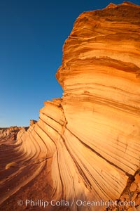 Sandstone &#34;fins&#34;, eroded striations that depict how sandstone -- ancient compressed sand -- was laid down in layers over time.  Now exposed, the layer erode at different rates, forming delicate &#34;fins&#34; that stretch for long distances, Navajo Tribal Lands, Page, Arizona