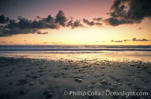 Sunset, cobblestones, surf and sand, Torrey Pines State Beach, Torrey Pines State Reserve, San Diego, California