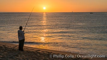 Surf fisherman on Medano Beach at sunrise, Cabo San Lucas, Mexico