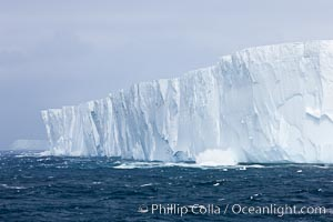 Tabular iceberg.  The edge of a huge tabular iceberg.  Tabular icebergs can be dozens or hundreds of miles in size, have flat tops and sheer sides, Scotia Sea