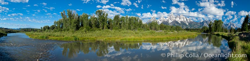 Panoramic photo of the Teton Range, reflected in the still waters of Schwabacher Landing, a sidewater of the Snake River, Grand Teton National Park, Wyoming
