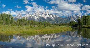 Panorama of the Teton Range, reflected in the still waters of Schwabacher Landing, a sidewater of the Snake River, Grand Teton National Park, Wyoming