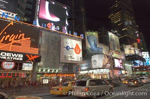 Neon lights fill Times Square at night, New York City