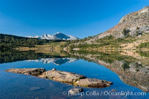Sunrise reflections in Tioga Lake. This spectacular location is just a short walk from the Tioga Pass road. Near Tuolumne Meadows and Yosemite National Park