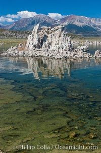 Tufa towers rise from Mono Lake with the Eastern Sierra visible in the distance.  Tufa towers are formed when underwater springs rich in calcium mix with lakewater rich in carbonates, forming calcium carbonate (limestone) structures below the surface of the lake.  The towers were eventually revealed when the water level in the lake was lowered starting in 1941.  South tufa grove, Navy Beach