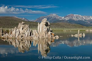 Tufa towers rise from Mono Lake, with the Eastern Sierra visible in the distance. Tufa towers are formed when underwater springs rich in calcium mix with lakewater rich in carbonates, forming calcium carbonate (limestone) structures below the surface of the lake. The towers were eventually revealed when the water level in the lake was lowered starting in 1941