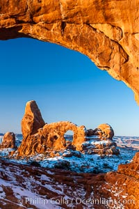 Sunrise light on Turret Arch viewed through North Window, winter, Arches National Park, Utah
