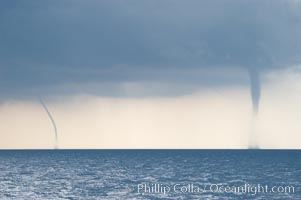 Two simultaneous waterspouts.  Waterspouts are tornadoes that form over water.,  Copyright Phillip Colla, image #10854, all rights reserved worldwide.