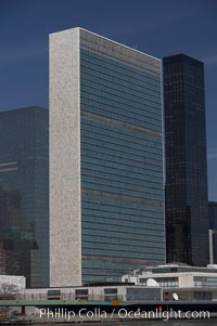 The United Nations Building rises above the New York skyline as viewed from the East River, Manhattan, New York City