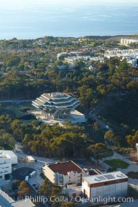 University of California San Diego, with Geisel Library (UCSD Main library) seen amid a grove of eucalyptus trees, with the Pacific Ocean in the distance, La Jolla