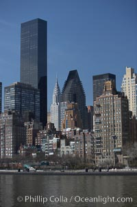 New York Citys Upper East Side, viewed from the East River. The Trump World Tower rises in the background and, in the distance, the Chrysler Building. Manhattan, New York City, New York, USA, natural history stock photograph, photo id 11138