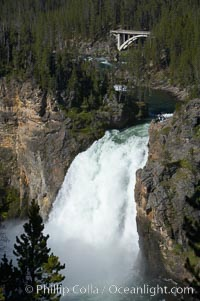 Hikers can be seen at the brink of the Upper Falls of the Yellowstone River, a 100 foot plunge at the head of the Grand Canyon of the Yellowstone, Yellowstone National Park, Wyoming