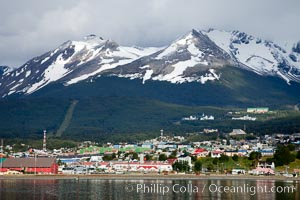 Ushuaia, the southernmost city in the world, lies on the Beagle Channel with a small portion of the Andes mountain range rising above.  Ushuaia is the capital of the Tierra del Fuego region of Argentina and the gateway port for many expeditions to Antarctica. Ushuaia, Tierra del Fuego, Argentina, natural history stock photograph, photo id 23602