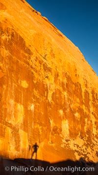 Rising sun creates the photographers shadow on a sandstone wall, Valley of Fire State Park
