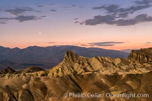 Venus sets over Manley Beacon and the Panamint Mountains, viewed from Zabriskie Point, landscape lit by a full moon, evening, stars. Zabriskie Point, Death Valley National Park, California, USA, natural history stock photograph, photo id 28677
