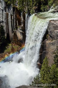 Vernal Falls at peak flow in late spring, hikers visible at precipice, viewed from John Muir Trail, Yosemite National Park, California