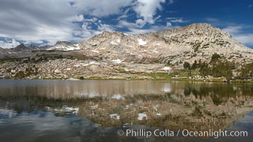 Vogelsang Peak reflected in spectacular Vogelsang Lake, in Yosemite's high country near the John Muir Trial and Vogelsang High Sierra Camp.  Vogelsang Peak (11516') was sculpted by glaciers from monolithic granite, Yosemite National Park, California