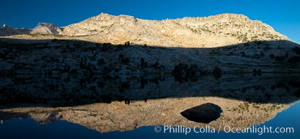 Vogelsang Peak (11500', at left) reflected in Vogelsang Lake, sunrise, Yosemite National Park, California