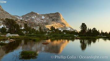 Vogelsang Peak (11516&#39;) at sunset, reflected in a small creek near Vogelsang High Sierra Camp in Yosemite&#39;s high country, Yosemite National Park, California
