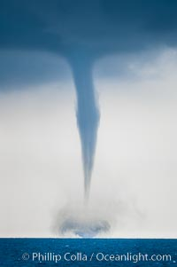 A mature waterspout, seen extending from clouds above to the ocean surface.  A significant disturbance on the ocean is clearly visible, the waterspout has reached is maximum intensity.   Waterspouts are tornadoes that form over water. Great Isaac Island, Bahamas, natural history stock photograph, photo id 10851