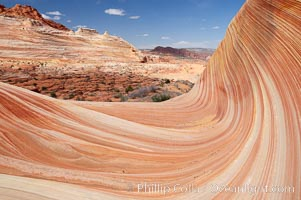 The Wave, an area of fantastic eroded sandstone featuring beautiful swirls, wild colors, countless striations, and bizarre shapes set amidst the dramatic surrounding North Coyote Buttes of Arizona and Utah.  The sandstone formations of the North Coyote Buttes, including the Wave, date from the Jurassic period. Managed by the Bureau of Land Management, the Wave is located in the Paria Canyon-Vermilion Cliffs Wilderness and is accessible on foot by permit only. North Coyote Buttes, Paria Canyon-Vermilion Cliffs Wilderness, Arizona, USA, natural history stock photograph, photo id 20644