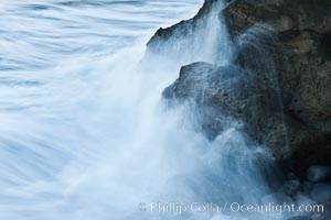 Waves wash over coast rocks, La Jolla, California