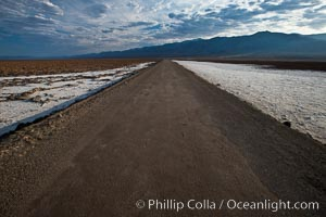 Image 25302, West Side Road cuts across the Badwater Basin. Badwater, Death Valley National Park, California, USA