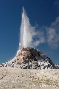 White Dome Geyser rises to a height of 30 feet or more, and typically erupts with an interval of 15 to 30 minutes.  It is located along Firehole Lake Drive. Lower Geyser Basin, Yellowstone National Park, Wyoming, USA