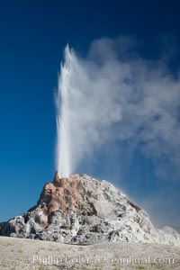 White Dome Geyser, rises to a height of 30 feet or more, and typically erupts with an interval of 15 to 30 minutes. It is located along Firehole Lake Drive, Lower Geyser Basin, Yellowstone National Park, Wyoming