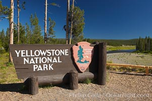 Yellowstone National Park, entrance sign at southern entrance, Snake River is visible in the background. Yellowstone National Park, Wyoming, USA, natural history stock photograph, photo id 13463