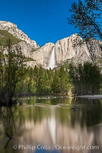 Yosemite Falls reflected in the Merced River, illuminated by moonlight, spring, Yosemite National Park, California
