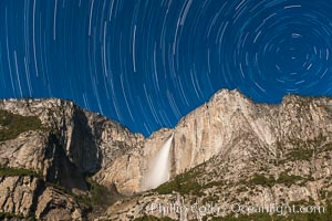Yosemite Falls and star trails, at night, viewed from Cook&#39;s Meadow, illuminated by the light of the full moon, Yosemite National Park, California