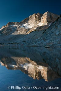 Cathedral Range peaks reflected in the still waters of Townsley Lake at sunrise. Yosemite National Park, California, USA, natural history stock photograph, photo id 25756