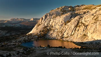 Fletcher Peak is reflected in Vogelsang Lake at sunset, viewed from near summit of Vogelsang Peak, Yosemite National Park, California