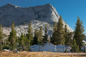 Vogelsang Peak (11500') rises above Vogelsang High Sierra Camp, in Yosemite's high country, with semi-permanent tent cabins serving camp visitors seen in the foreground, Yosemite National Park, California