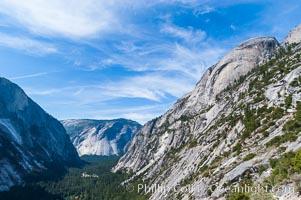 Basket Dome rises above Tenaya Canyon and Yosemite Valley, viewed from the Snow Creek Trail, Tenaya Lake, Yosemite National Park, California