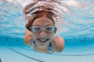 Young girl swimming in a pool, natural history stock photograph, photo id 25290