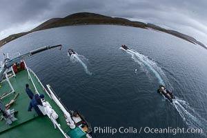 Zodiac boats, are lowered into the ocean from the ship M/V Polar Star in preparation for a day exploring New Island in the Falklands. New Island, Falkland Islands, United Kingdom, natural history stock photograph, photo id 23712