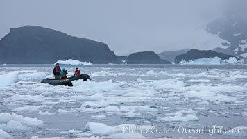 Zodiac cruising in Antarctica.  Motoring in an inflatable zodiac through pack ice along the Antarctic Peninsula, Cierva Cove