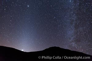 Zodiacal light and Milky Way over Death Valley.  Zodiacal light is a faint diffuse light seen along the plane of the ecliptic in the vicinity of the setting or rising sun, caused by sunlight scattered off space dust in the zodiacal cloud, Racetrack Playa, Death Valley National Park, California
