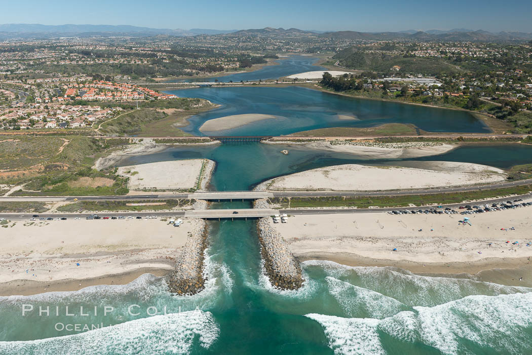 Aerial photo of Batiquitos Lagoon, Carlsbad. The Batiquitos Lagoon is a coastal wetland in southern Carlsbad, California. Part of the lagoon is designated as the Batiquitos Lagoon State Marine Conservation Area, run by the California Department of Fish and Game as a nature reserve. Carlsbad, Callifornia, USA, natural history stock photograph, photo id 30555