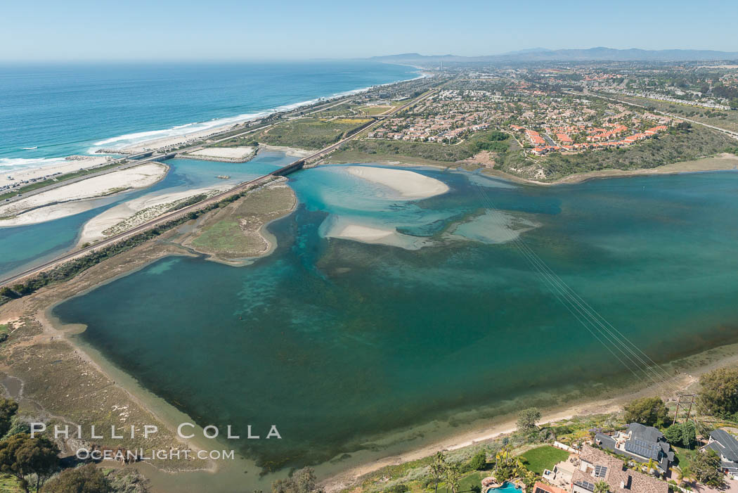 Aerial photo of Batiquitos Lagoon, Carlsbad. The Batiquitos Lagoon is a coastal wetland in southern Carlsbad, California. Part of the lagoon is designated as the Batiquitos Lagoon State Marine Conservation Area, run by the California Department of Fish and Game as a nature reserve. Carlsbad, Callifornia, USA, natural history stock photograph, photo id 30559
