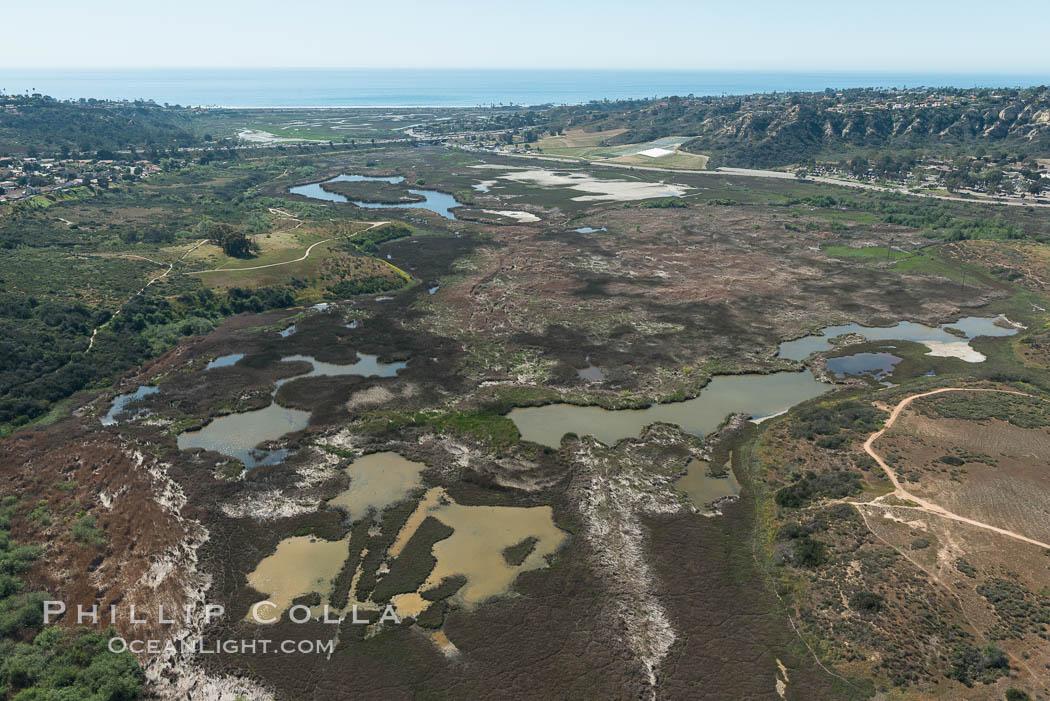 Aerial Photo of San Elijo Lagoon. San Elijo Lagoon Ecological Reserve is one of the largest remaining coastal wetlands in San Diego County, California, on the border of Encinitas, Solana Beach and Rancho Santa Fe. Encinitas, California, USA, natural history stock photograph, photo id 30588