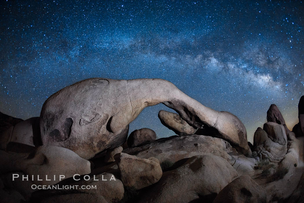 The Milky Way galaxy above Arch Rock, Joshua Tree National Park, night star field exposure