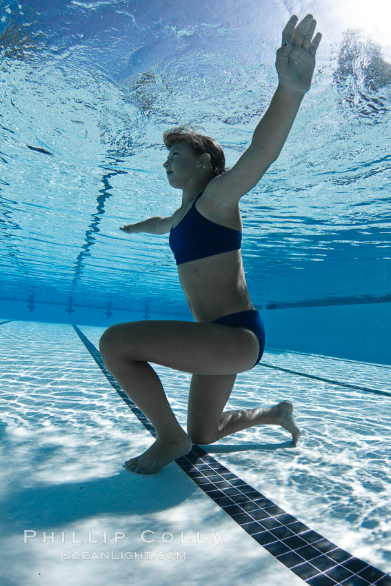 Athletic young girl underwater, performing isometric exercises., natural history stock photograph, photo id 27058